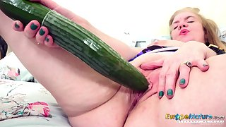 Some big ass cucumber for an ancient woman's hot to trot pussy